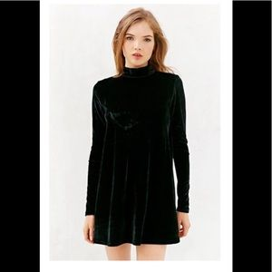 Black long sleeve mock turtleneck swing dress